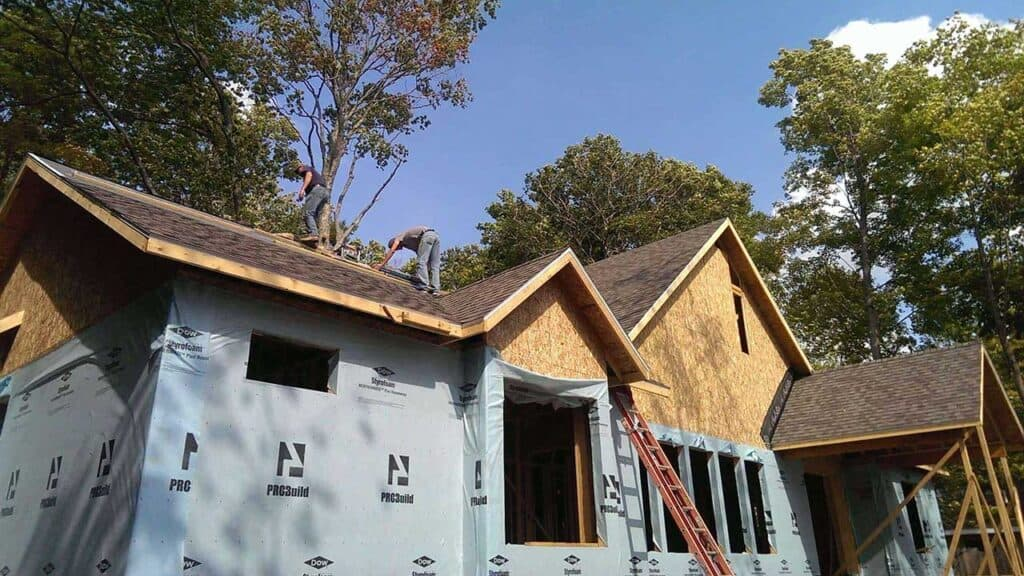 Lakeshore Custom Home roofers at work